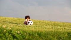 Stock Video Footage of Little cute girl runs with inflatable soccer balloon green meadow
