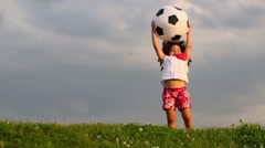 Stock Video Footage of Little cute girl throws inflatable soccer balloon green meadow