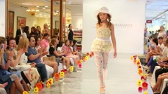 Girls go on catwalk during Fashion children clothing by designer Stock Footage