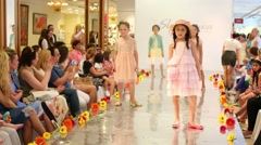 Cute girls go on catwalk during Fashion children clothing Stock Footage