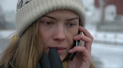 HD1080p25 Sexy woman with knit cap talking on cell phone. Stock Footage