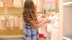 Girl chooses clothes in Children Gallery Jakimanka - stock footage