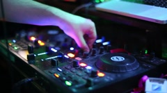 Hand of dj working in night club in many colored lights Stock Footage
