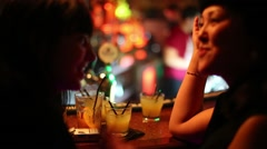 Women talk with cocktails in bar Theme in Moscow, Russia Stock Footage
