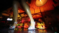 Legs of girl in high-heeled shoes dancing in Theme bar. Stock Footage