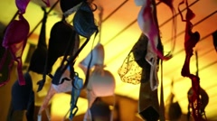 Female bras and male ties hand from ceiling in bar of night club Stock Footage