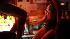 Parts of bodies of girls in black costumes dancing in Theme bar Stock Footage