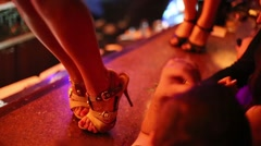 Legs of two women in high-heeled shoes dancing on bar Stock Footage