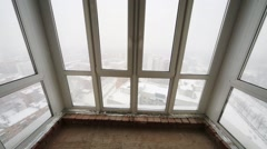 Stanza with large fiberglass windows in winter snowy day Stock Footage