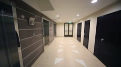 Metal doors of lifts in empty new residential building Stock Footage