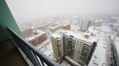 Balcony and many buildings in winter day with blizzard Stock Footage