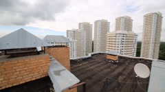 Roof and many tall residential buildings in city at overcast day Stock Footage