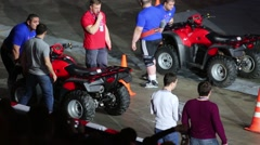 Two men push atv on festival extreme sports Breakthrough 2013 Stock Footage