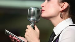 Woman speaks and leaves in competition of reciters Stock Footage