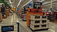 View from cart, walking down walmart aisle Stock Footage