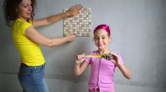 Stock Video Footage of Young woman with her daughter measure tile by tape rule