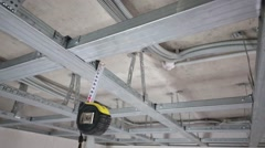 Stock Video Footage of Metal framework for hung ceiling and tape rule in new flat