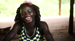 Africa village Cambessi teenage girl smiles to camera Guinea Bisseau Stock Footage