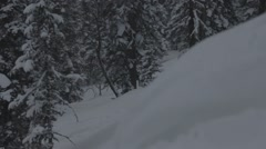 Tracking shot of Snowboarder jumps trick Stock Footage