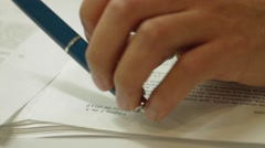 Close Up Shot of a professional worker checking a document Stock Footage