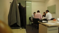 Zoom Out Shot of a work-related meeting at an office Stock Footage