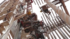 Low Angle Shot of machinery at an oil and gas Well Stock Footage