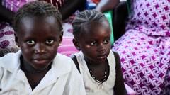 Africa village two children stairing Guinea Bisseau Stock Footage