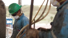 Perspective Shot of two oil and gas Workers Stock Footage