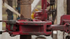 Close Up Shot of machinery at an oil well Stock Footage