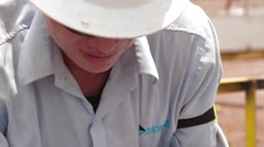 Close Up Shot of an oil and gas worker Stock Footage