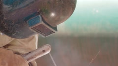 Close Up Shot of an oil and gas worker welding something - stock footage