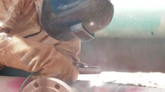 Close Up Shot of an oil and gas worker welding a pipe - stock footage