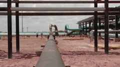 Wide Angle Shot of Pipes and infrastructure inside an Oil Well Stock Footage