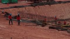 Close Up Shot of oil and gas workers walking across a construction site Stock Footage