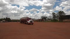 Wide Angle Shot of a Tank Truck entering an oil and gas field Stock Footage