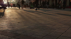 People walking at street on sunset light Stock Footage