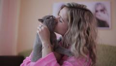 The girl kisses the cat. Sexy girl Stock Footage