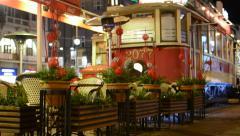 Restaurant (vintage tram)  - outdoor seating - people walking Stock Footage
