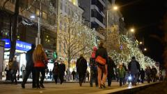 Wenceslas Square with people and cars- buildings - night - christmas decorations Stock Footage