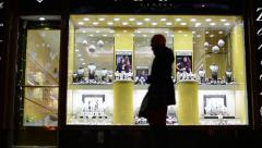 Jewelry shop (shop window) on urban street - walking people Stock Footage