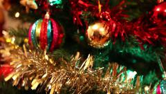 Pan on beautiful decorated christmas tree, tinsel, balls and lights Stock Footage