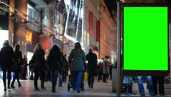 Billboard in the city - urban street with buildings - green screen - people Stock Footage