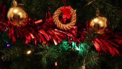 Pan on beautiful decorated christmas tree, tinsel, balls and lights - stock footage