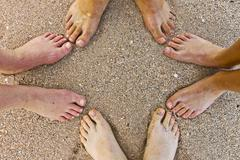 feet of family at the beach - stock photo