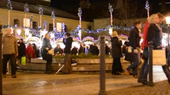 Christmas marketplace (shops) with people on the street - decorations - building Stock Footage