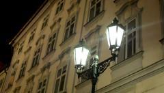 Night urban street - lamp - night exterior vintage building - windows Stock Footage