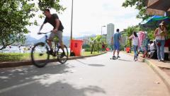 People enjoying a hot day in Lagoa Rodrigo Freitas in Rio de Janeiro, Brazil. Stock Footage