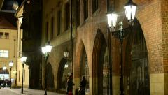 night urban street with people - lamps in row - night exterior building - stock footage