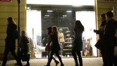 Clothing store - shop window - urban street with walking people - night Stock Footage