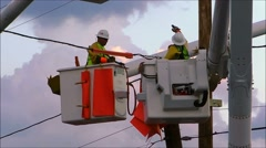 Telephone pole power line workers Stock Footage